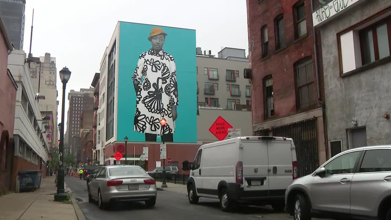 Michelle Obama portrait artist unveils mural of Philly teen