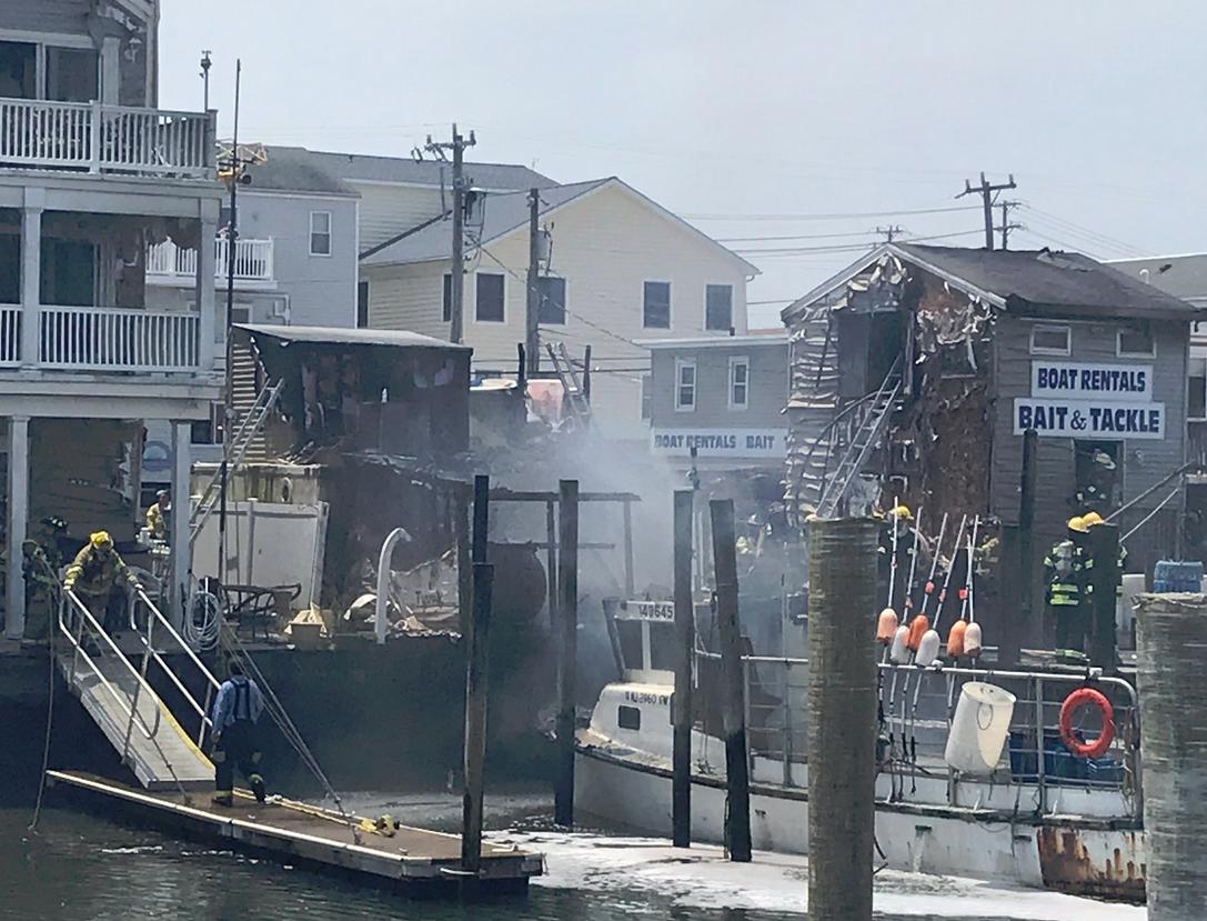 Crews battle heavy fire at boat rental shop in Sea Isle