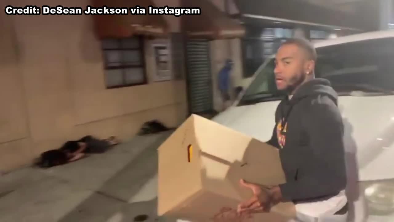 Eagles receiver DeSean Jackson hands out boxes of food