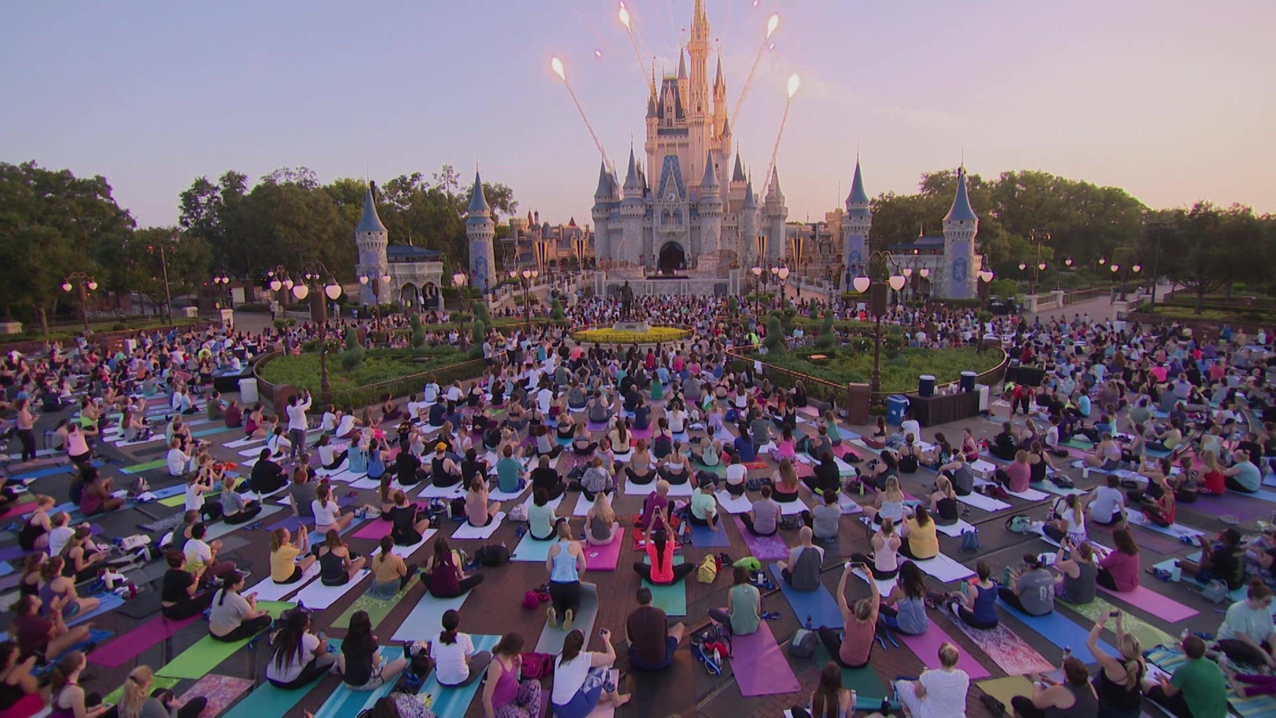 Thousands of employees do yoga at Disney's Magic Kingdom